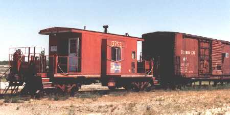 The caboose and the box car share the site